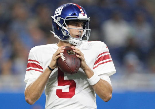 Aug 17, 2018; Detroit, MI, USA; New York Giants quarterback Davis Webb (5) looks for an open man during the first quarter against the Detroit Lions at Ford Field.