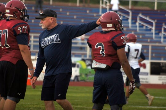Coach Greg Simmons touted his Wildcat football players for a strong effort during Friday's Cardinal-Navy game at Memorial Stadium.