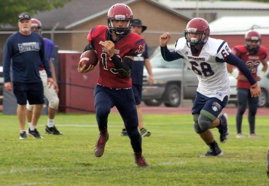 Junior James (13) Carroll ran strong off the edge during Friday's Cardinal-Navy game at Memorial Stadium.