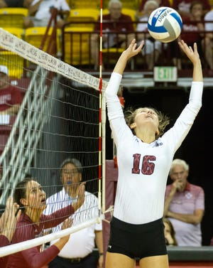 New Mexico State University's Natalie Mikels sets the ball while Savannah Davison keeps her eye on the ball on Saturday August 18, 2018, during the Crimson and White Scrimmage at the Pan American Center.