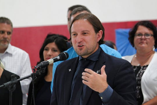 In this July 12, 2018 file photo, New Mexico Public Education Secretary Christopher Ruszkowski announces the results of this year's standardized assessments during an event at North Valley Academy in Los Ranchos, N.M. New Mexico school districts now will get student test scores by the end of the school year and will have 15 more days to prepare for statewide exams Ruszkowski said Tuesday, Aug. 14, 2018, after receiving feedback.