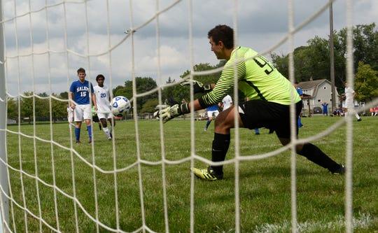 Salem goalkeeper Buraq Oral makes his move during Saturday's Balconi Invitational boys soccer tourney.