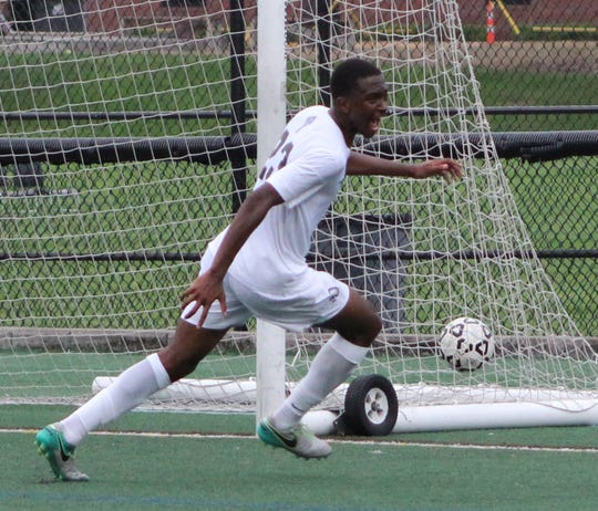 Brother Rice forward DaVion Page celebrates Brother Rice's first half goal Friday night against neighboring rival Seaholm.
