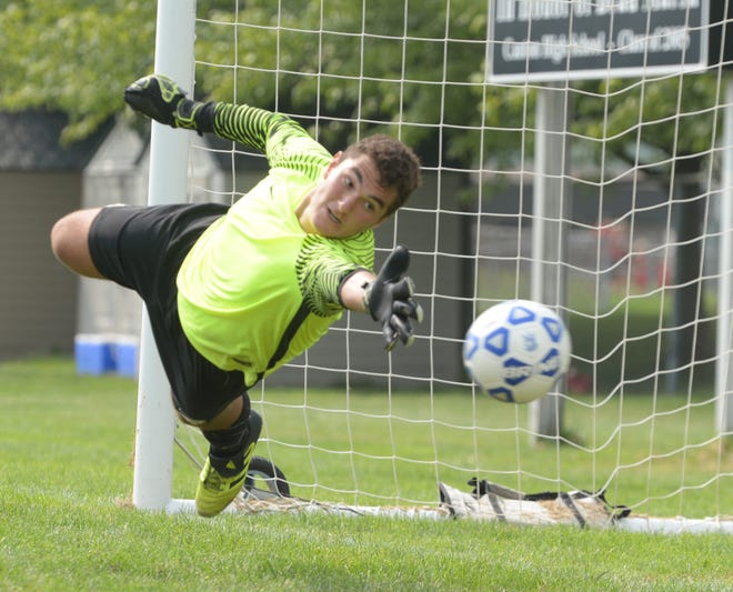 Salem senior goalkeeper Buraq Oral tries for the save in vain during a shootout win over defending Division 1 state champion Detroit Catholic Central.