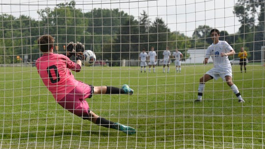 Plymouth goalkeeper Jack Reed makes the save against Detroit Catholic Central during a shootout in the Balconi Invitational.