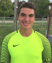 Salem senior goalkeeper Buraq Oral was all smiles after his team won the Balconi Invitational.