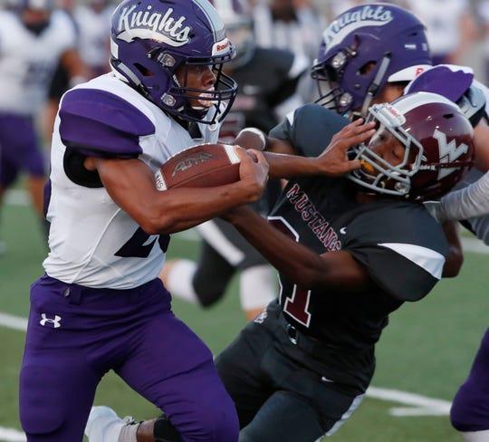Shadow Hills High School's Lee Hawkins runs for yardage during their game against West Valley in Hemet on August 17, 2018.