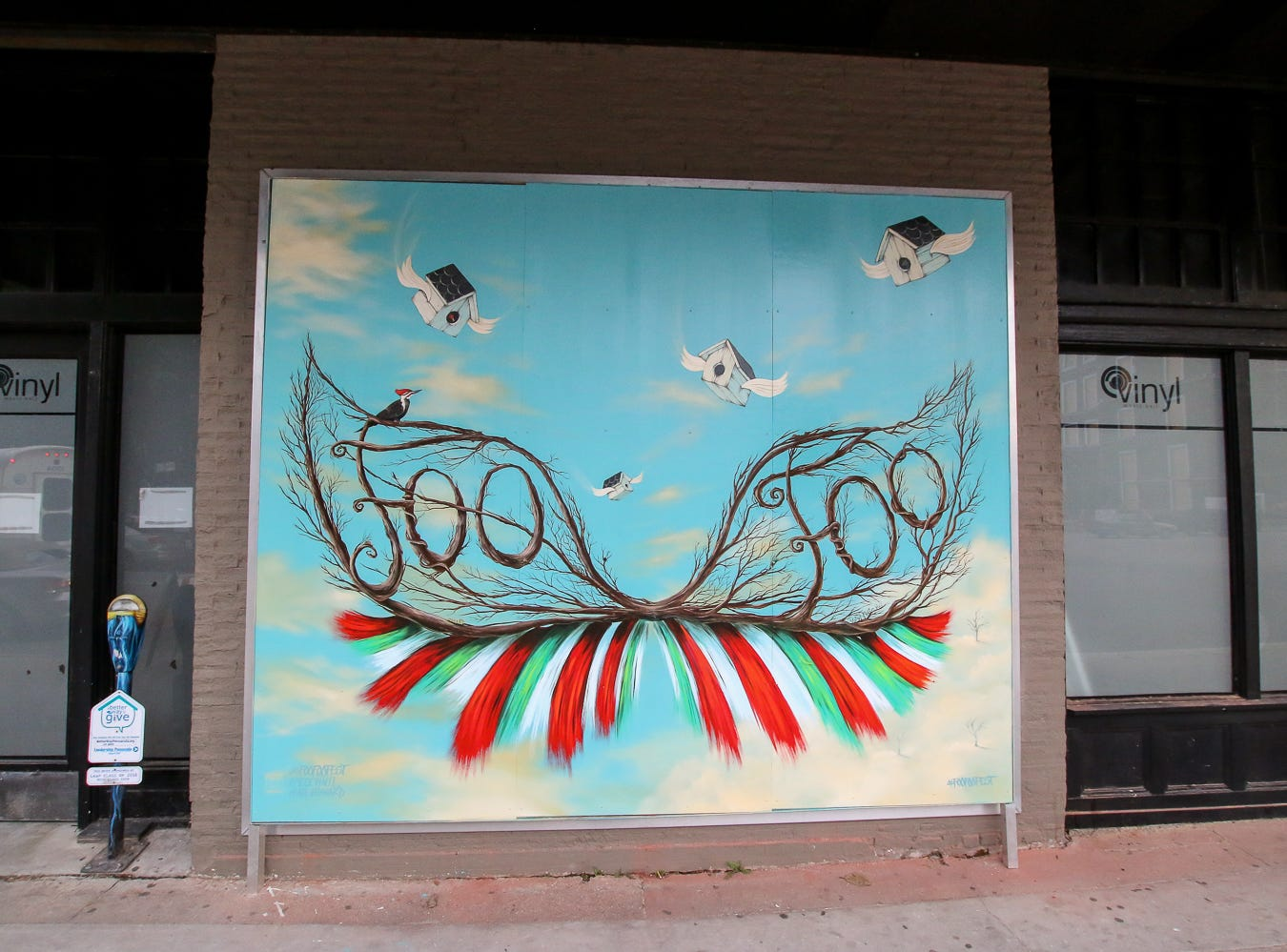 A new Foo Foo Festival mural is displayed on the side of Vinyl Music Hall during Gallery Night on Friday, August 17, 2018.