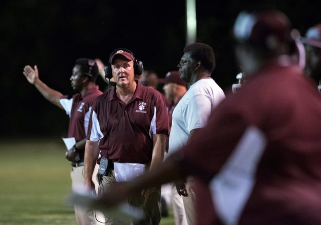 Pensacola High Football coach Mike Mincy looks for answers from his staff during Friday's preseason opener against Tate.