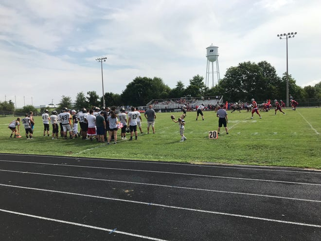 The New Oxford Colonials face off against the Biglerville Canners in a scrimmage at Biglerville High School on August, 18, 2018.