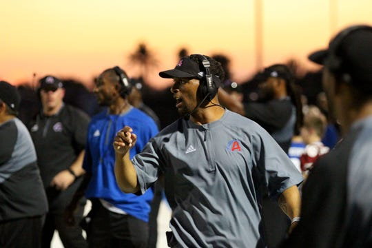 Arcadia coach Kerry Taylor gives his team instructions from the sideline against Coronado, Phoenix, Ariz. August 17, 2018.