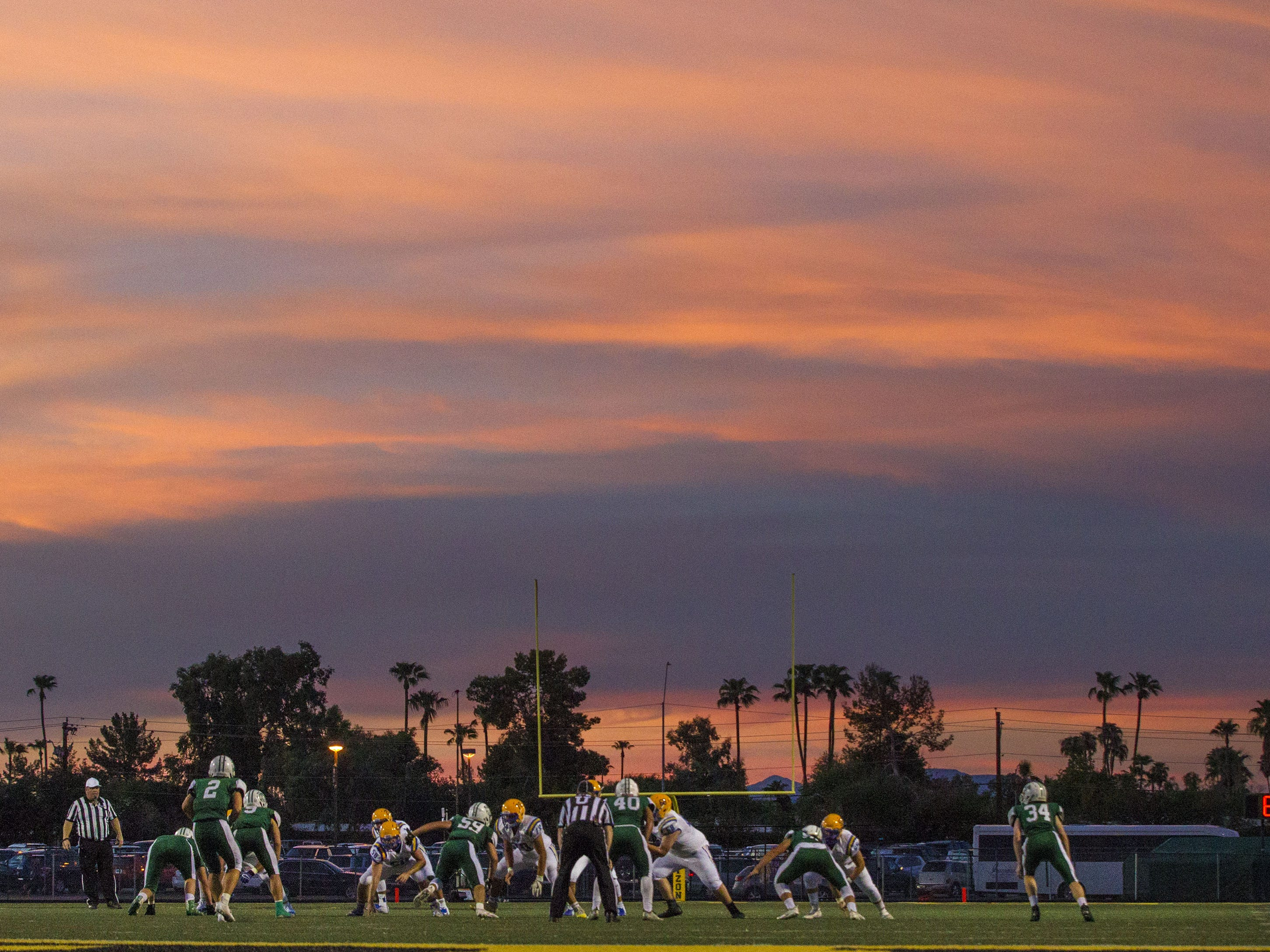 Marana and Horizon start on their football season off under ominous skies Friday, Aug.17, 2018.(Darryl Webb/For the Republic)