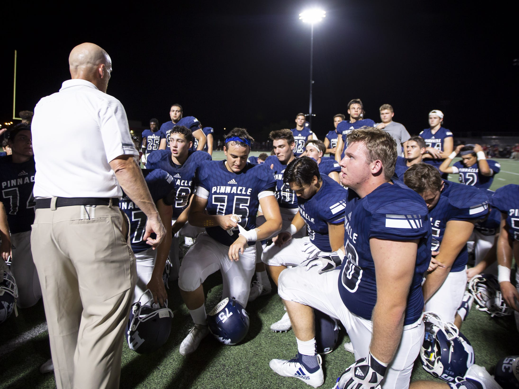Head coach Dana Zupke of the Pinnacle Pioneers speaks following Pinnacle's win against the Perry Pumas at Pinnacle High School on Friday, August 17, 2018 in Phoenix, Arizona.