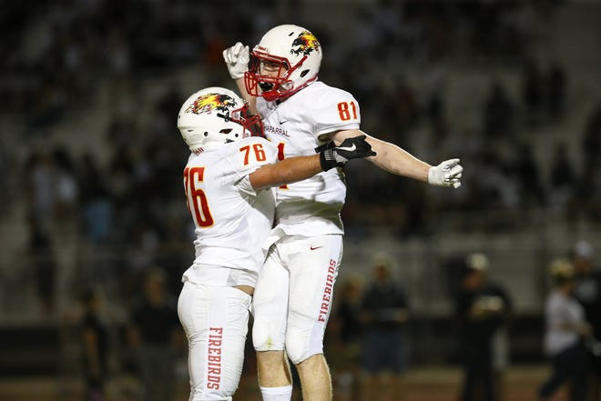 Chaparral's Tommy Christakos (81) celebrates a touchdown with teammate Sam Wiener (76) during a game at Hamilton on Aug. 17, 2018.