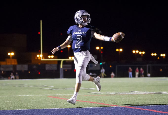 Quarterback Spencer Rattler (2) of the Pinnacle Pioneers runs the ball in for a touch-down against the Perry Pumas at Pinnacle High School on Friday, August 17, 2018 in Phoenix, Arizona.