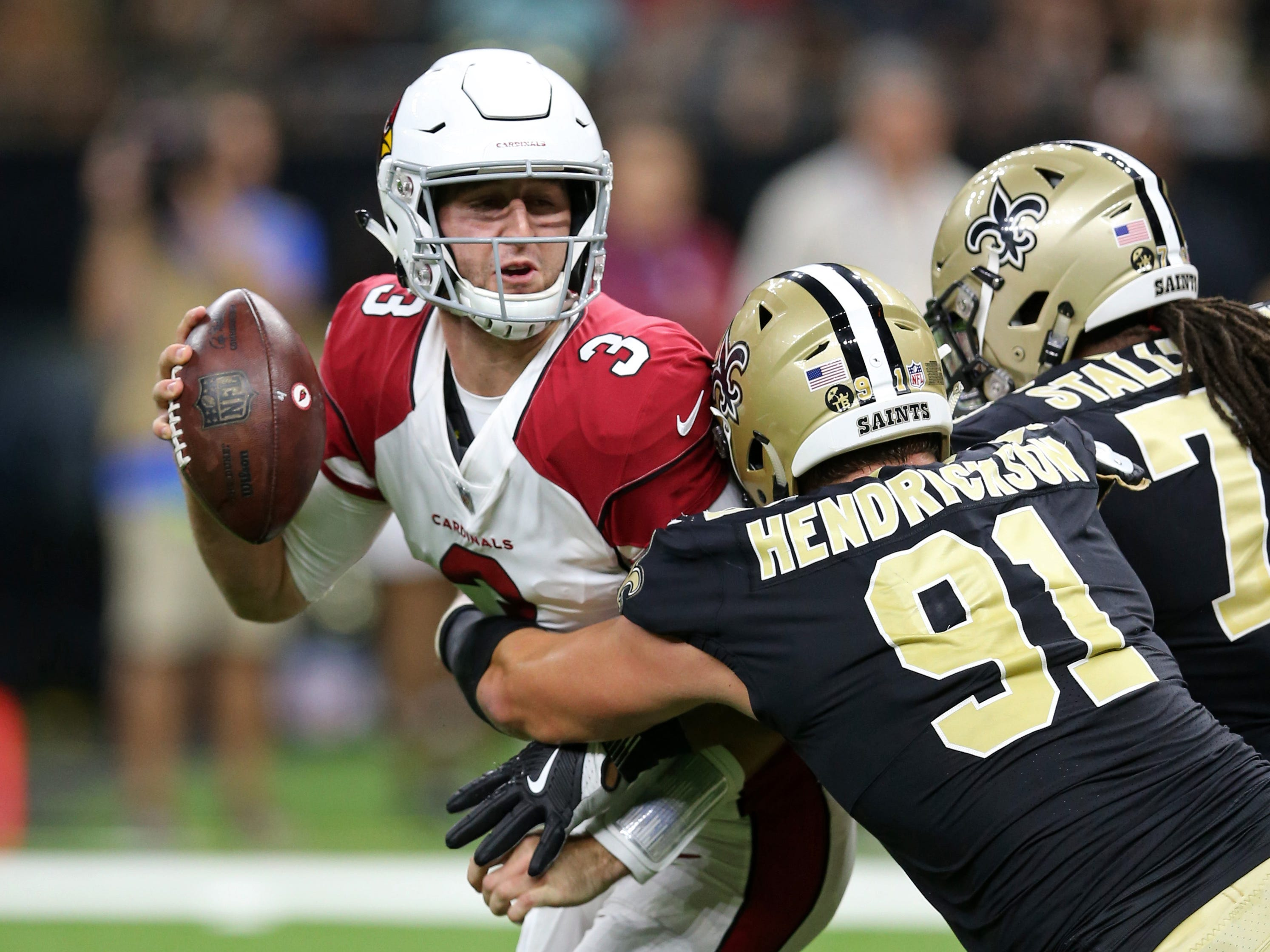 Aug 17, 2018: Arizona Cardinals quarterback Josh Rosen (3) is pressured by New Orleans Saints defensive end Trey Hendrickson (91) and defensive tackle Taylor Stallworth (76) during the second quarter at the Mercedes-Benz Superdome.