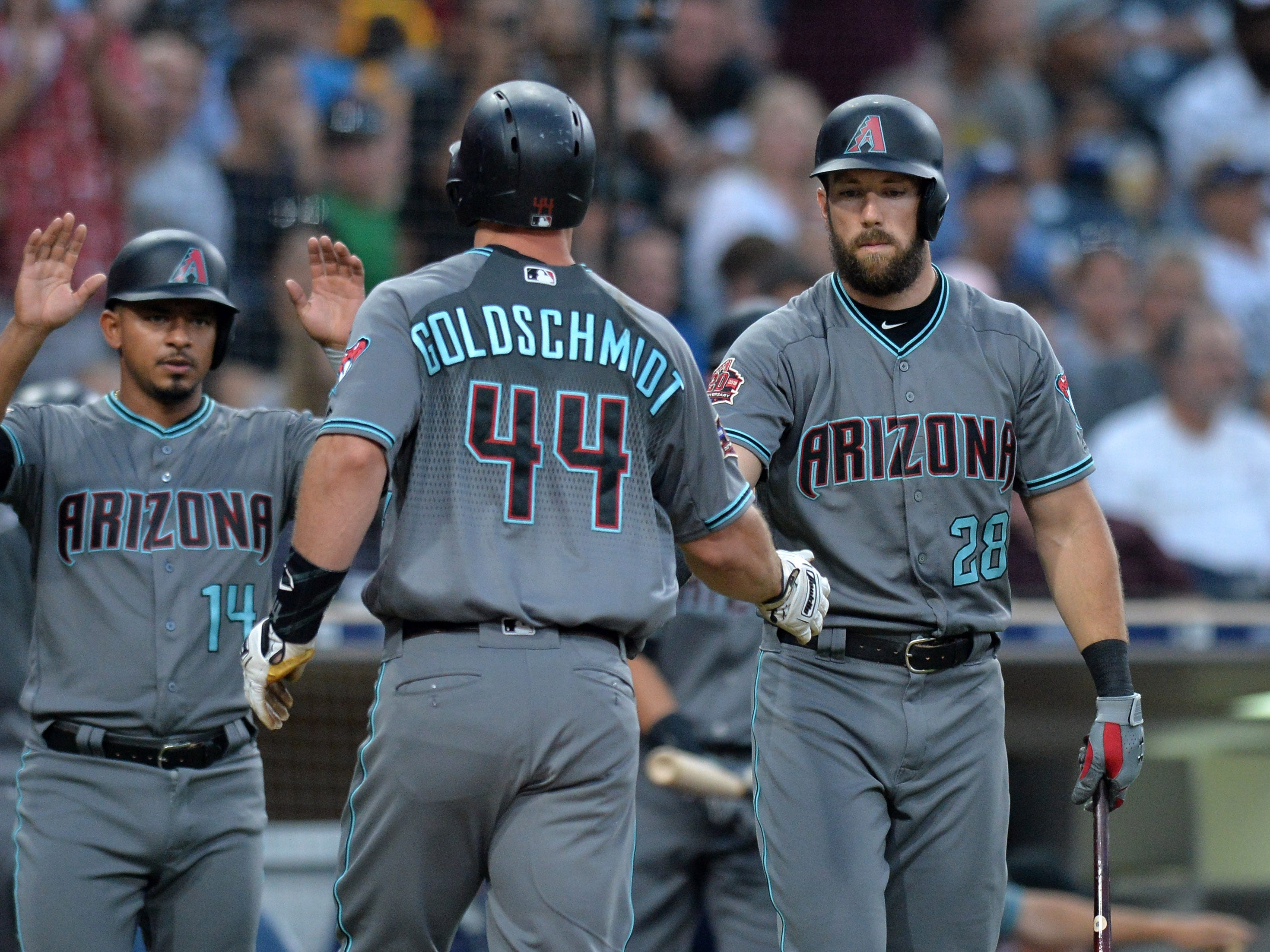 Aug 17, 2018: Arizona Diamondbacks first baseman Paul Goldschmidt (44) is congratulated by right fielder Steven Souza Jr. (28) and third baseman Eduardo Escobar (14) after hitting a two run home run during the first inning against the San Diego Padres at Petco Park.