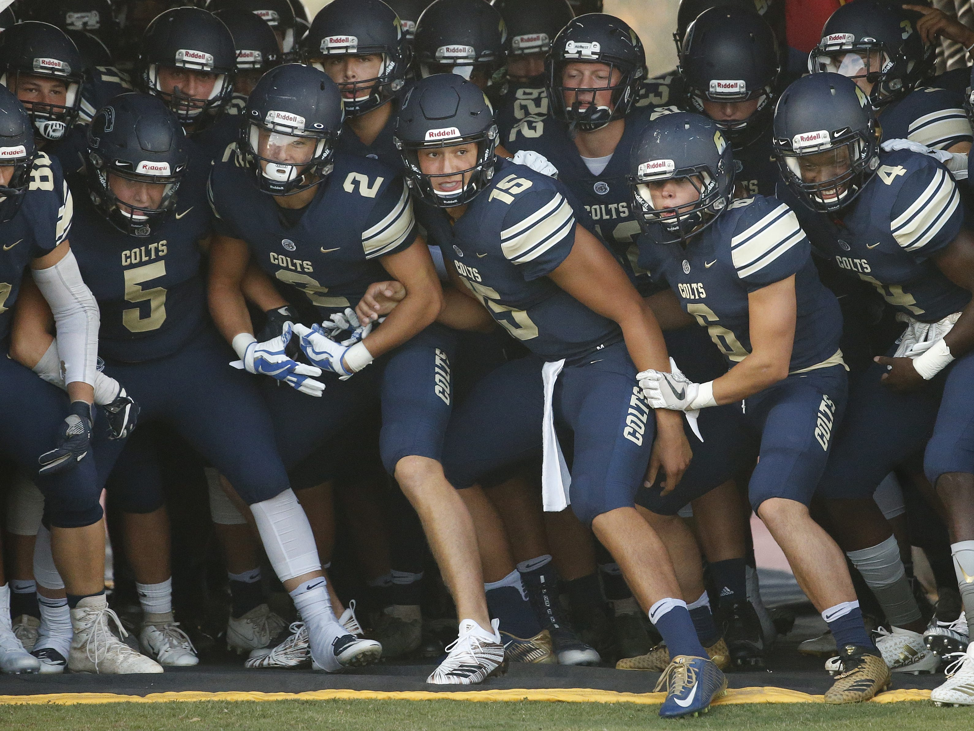 Casteel takes the field to play Centennial at Casteel High School in Queen Creek, Ariz. on Aug. 17, 2018.