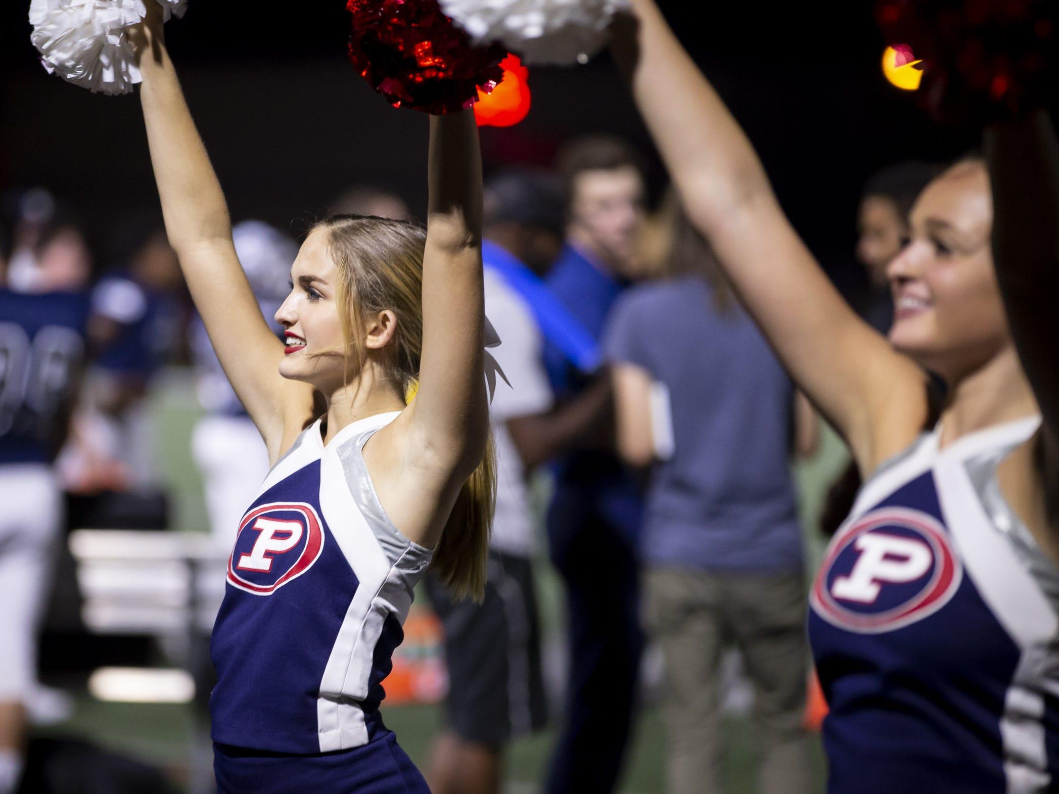 Pinnacle cheerleader Shaye Bergstrom cheers during the game against the Perry Pumas at Pinnacle High School on Friday, August 17, 2018 in Phoenix, Arizona.