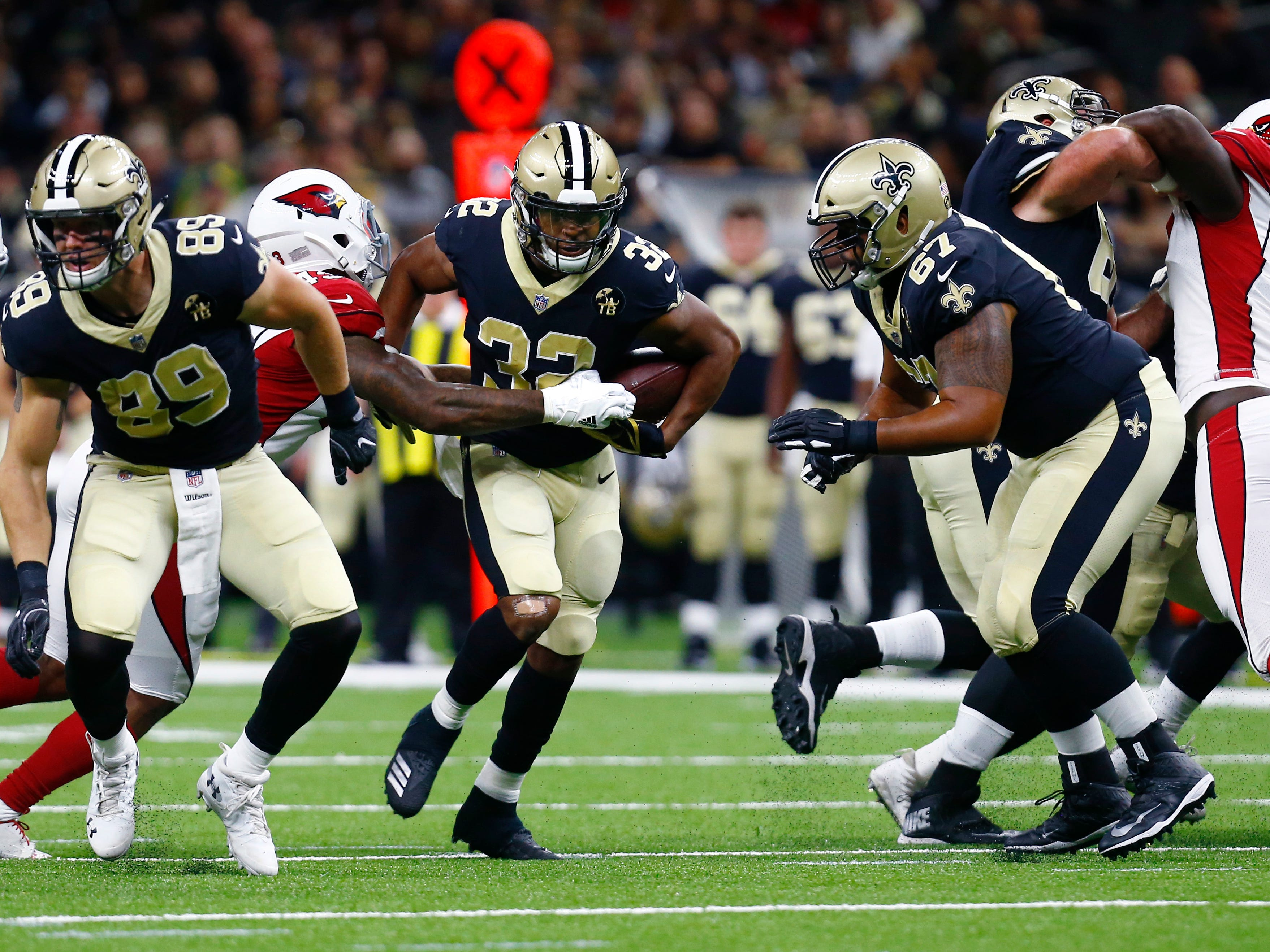 New Orleans Saints running back Jonathan Williams (32) carries in the first half of an NFL preseason football game against the Arizona Cardinals in New Orleans, Friday, Aug. 17, 2018.