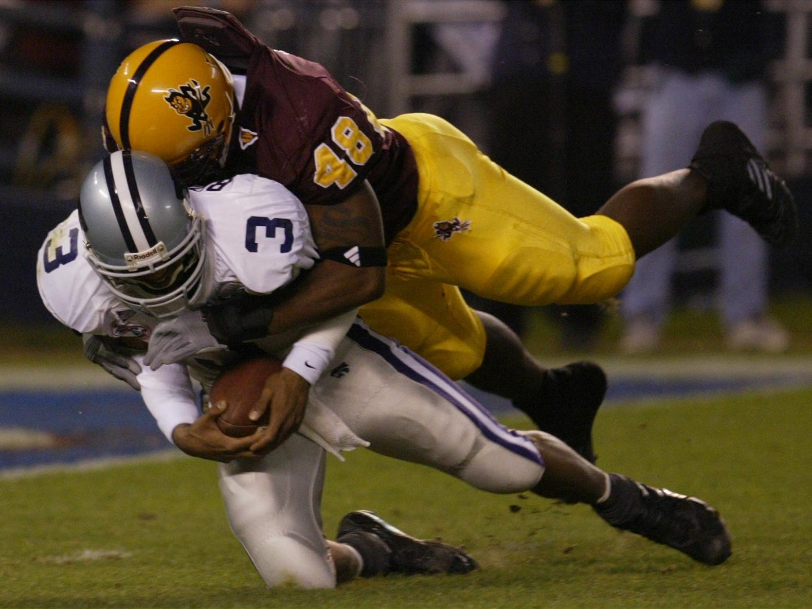 ASU's Terrell Suggs sacks Kansas State QB Ell Roberson #3 during first half action at the Holiday Bowl in San Diego, Calif., Dec. 27, 2002.