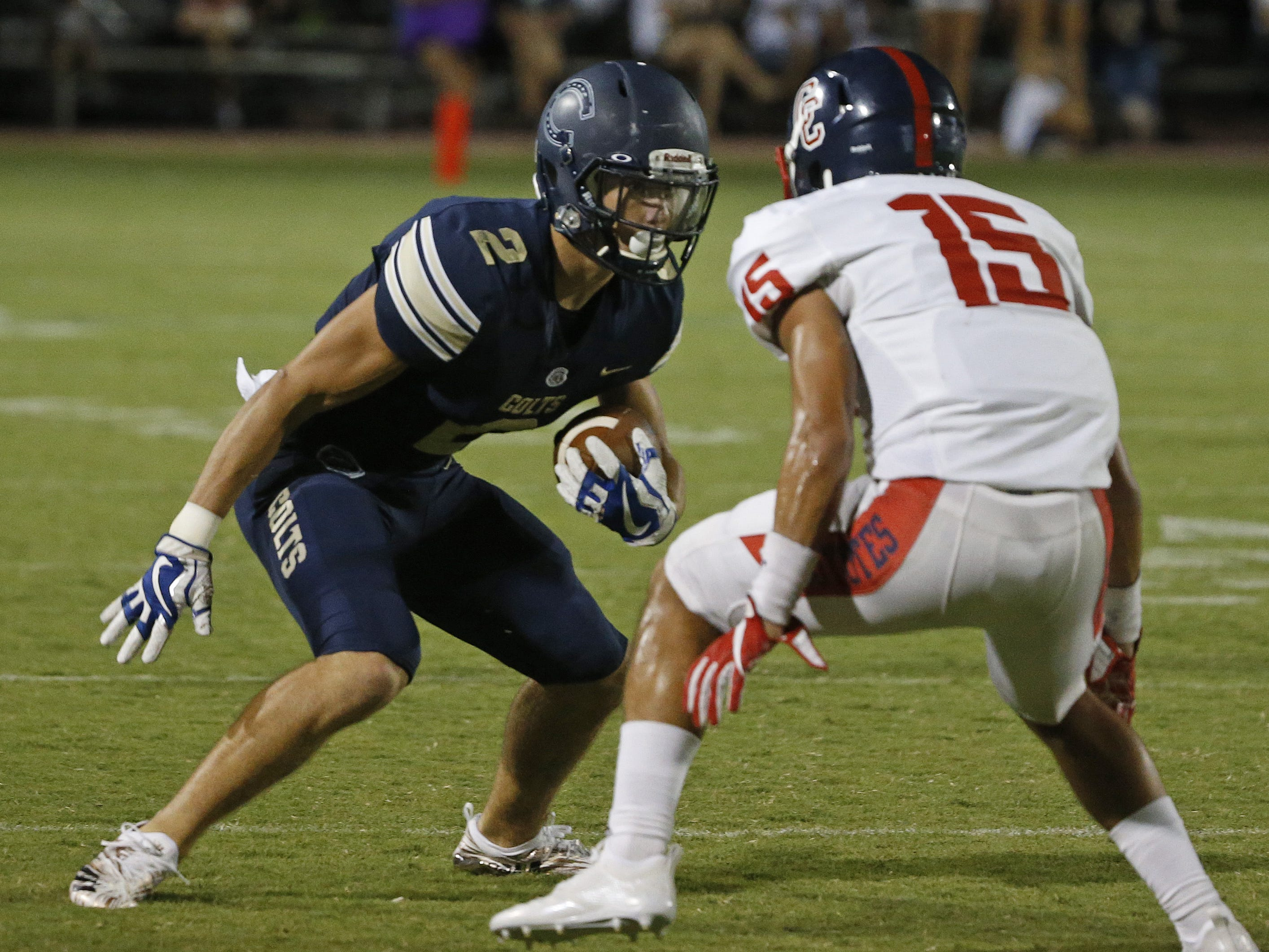 Centennial's Eric Haney (15) chases down Casteel's Zach Nelson (2) during the first half at Casteel High School in Queen Creek, Ariz. on Aug. 17, 2018.