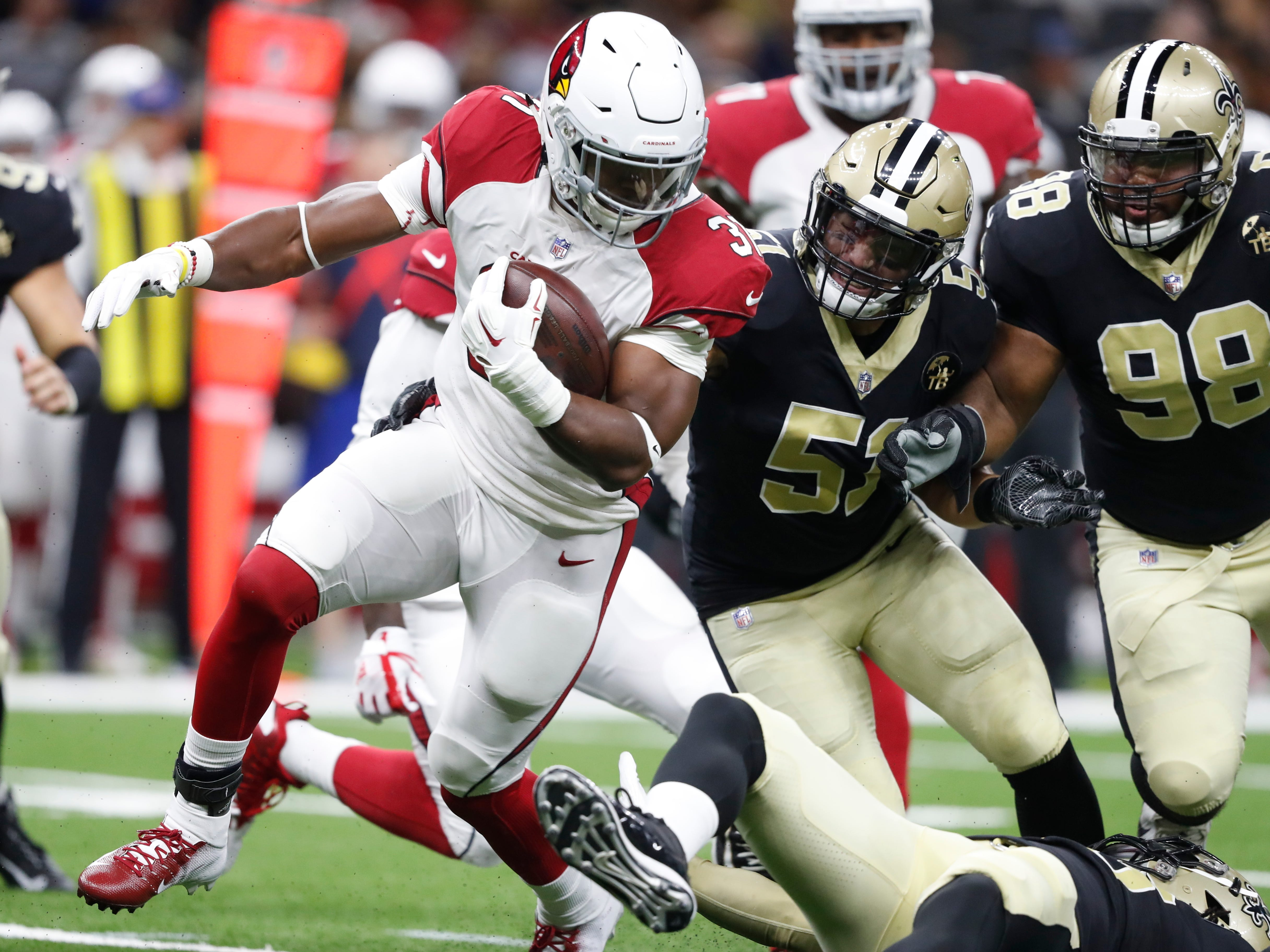 Arizona Cardinals running back David Johnson (31) carries against New Orleans Saints linebacker Manti Te'o in the first half of an NFL preseason football game in New Orleans, Friday, Aug. 17, 2018.