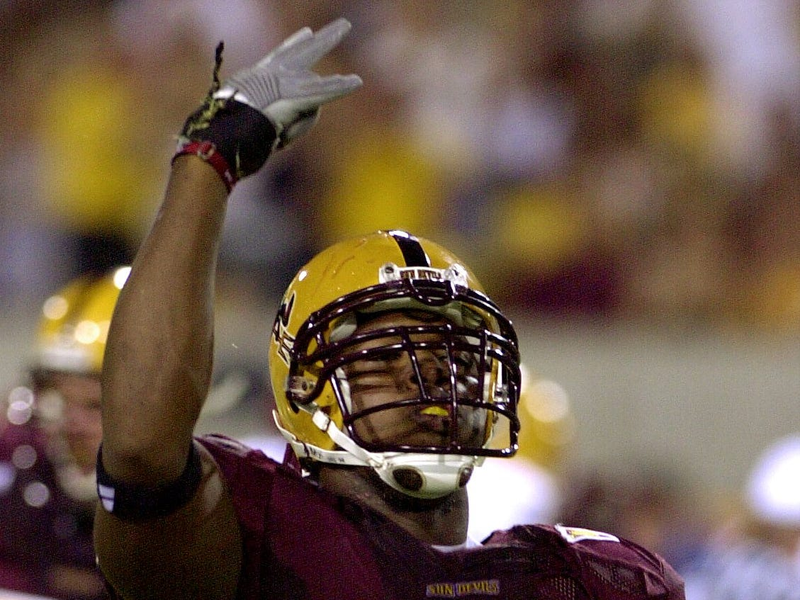 """ASU's Terrell Suggs shows the """"pitchfork"""" sign after stripping the away from San Diego's quarterback which lead to a turnover during the ASU season opener at Sun Devil Stadium in Tempe."""
