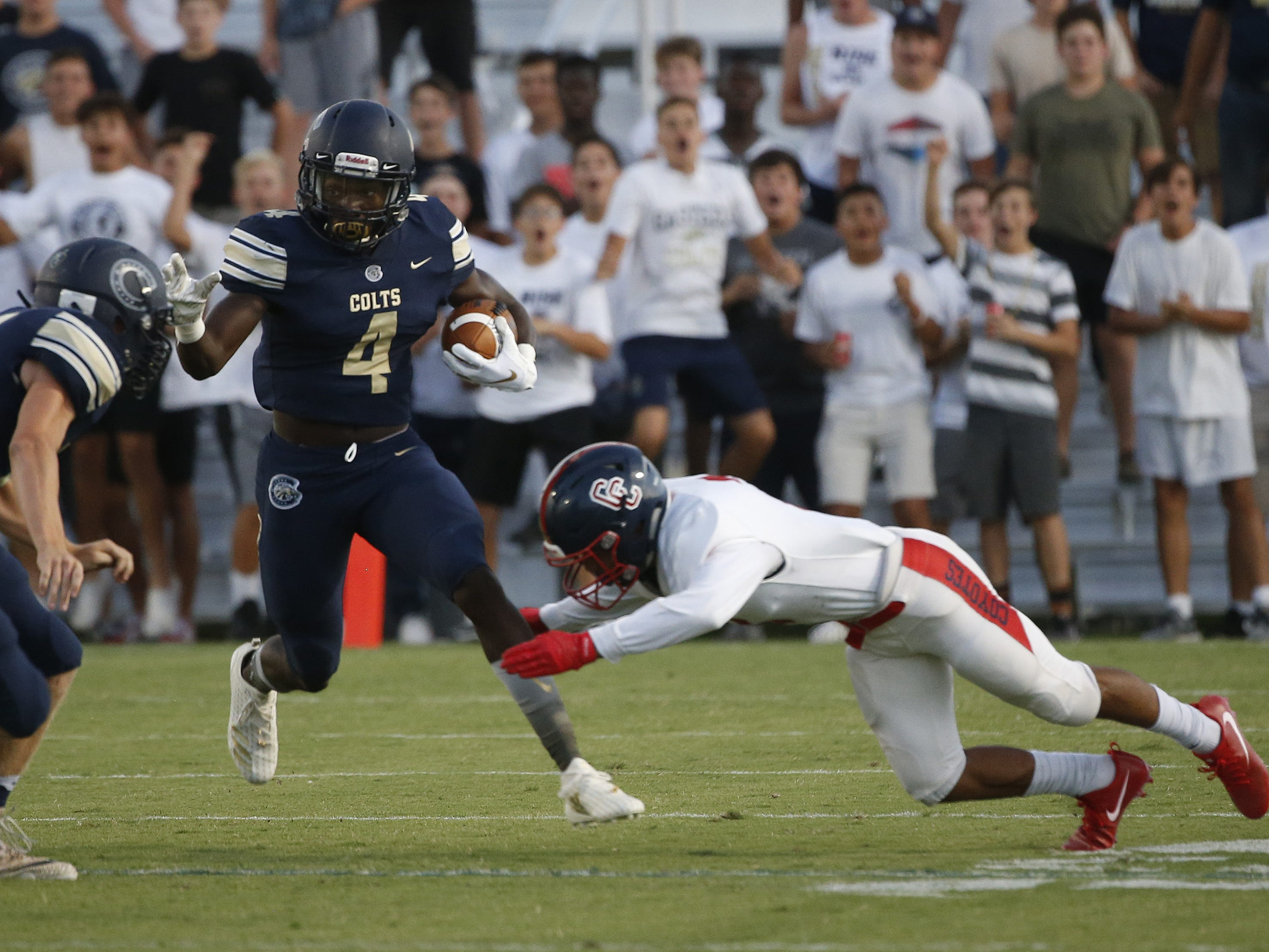 Casteel's Khyheem Waleed (4) returns a kick against Centennial during the first half at Casteel High School in Queen Creek, Ariz. on Aug. 17, 2018.