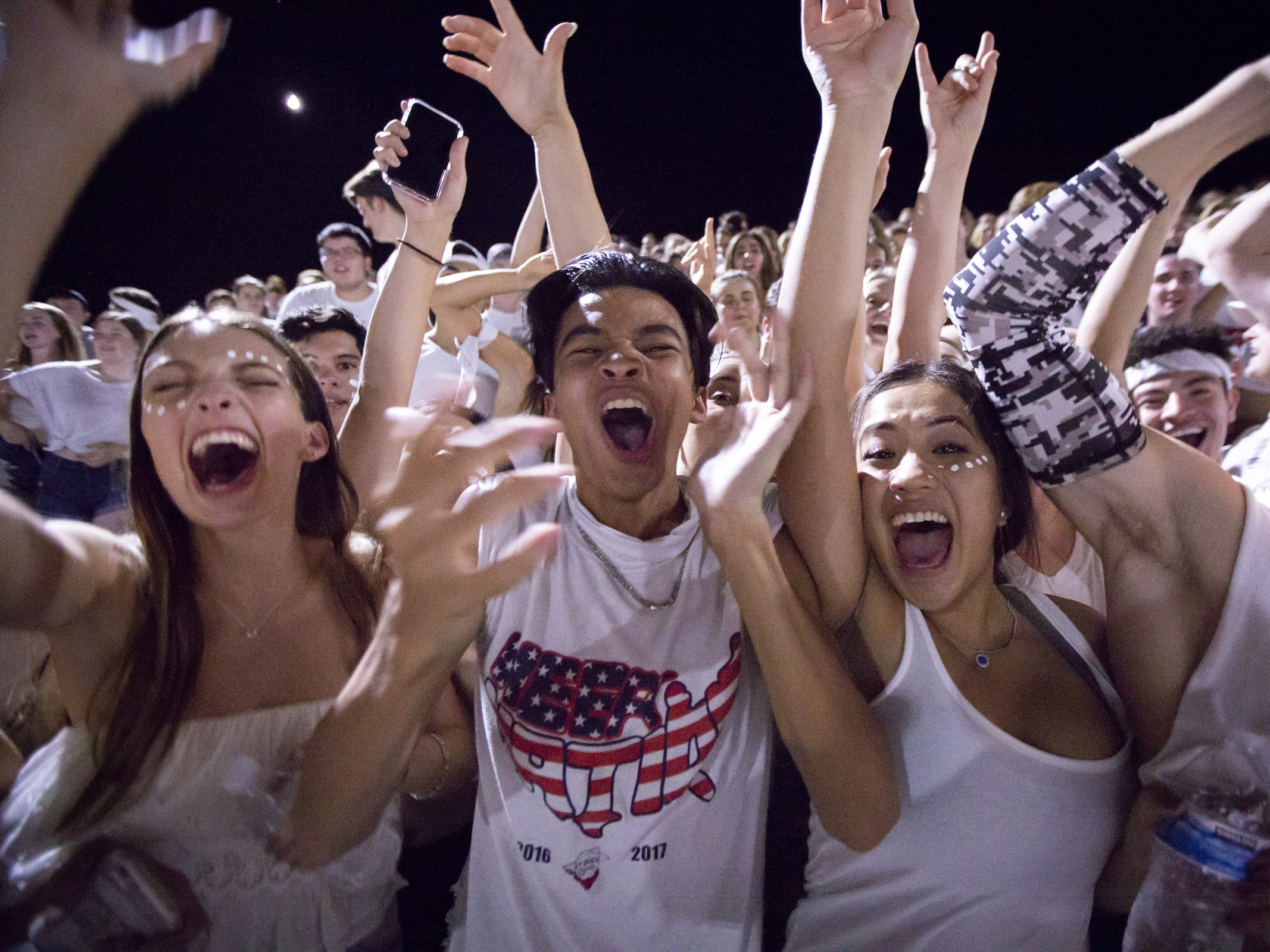 Pinnacle fans cheer during the game against the Perry Pumas at Pinnacle High School on Friday, August 17, 2018 in Phoenix, Arizona.