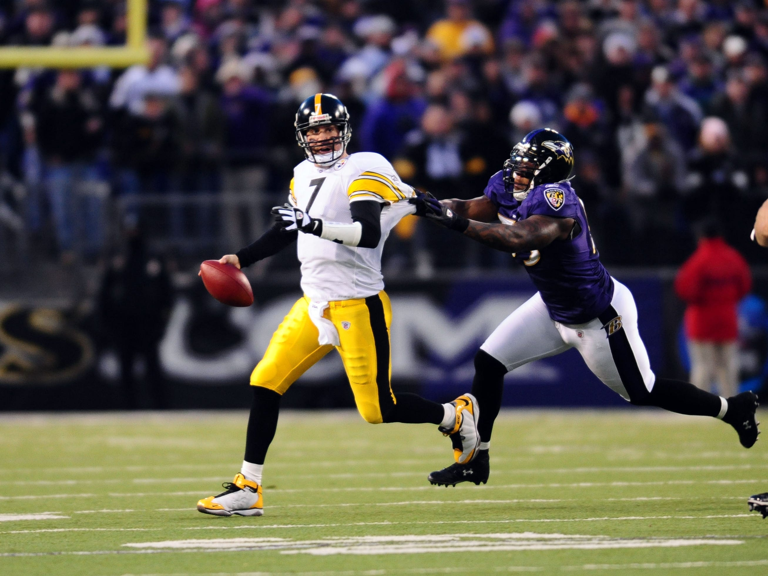 Baltimore, MD, USA; Pittsburgh Steelers quarterback Ben Roethlisberger (7) is chased by Baltimore Ravens linebacker Terrell Suggs (55) in the first quarter at M&T Bank Stadium.