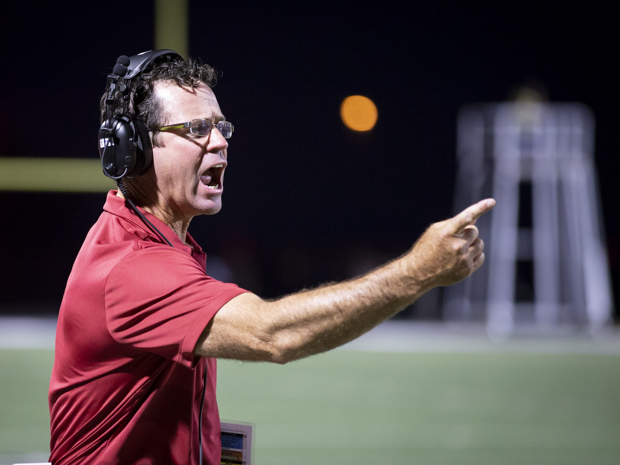Head coach Preston Jones of the Perry Pumas motions during the game against the Pinnacle Pioneers at Pinnacle High School on Friday, August 17, 2018 in Phoenix, Arizona.