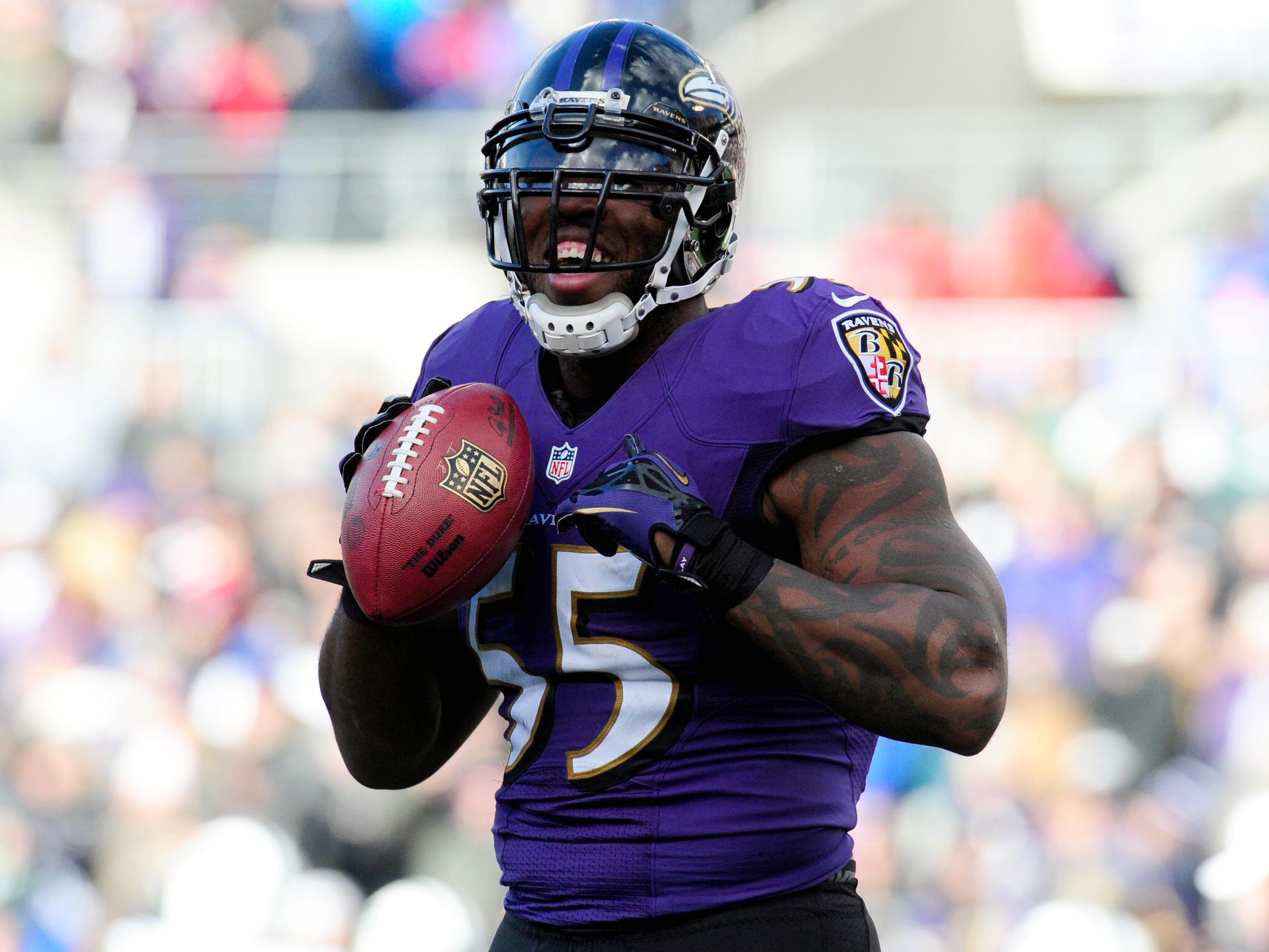 Baltimore Ravens linebacker Terrell Suggs (55) reacts after recovering a fumble in the second quarter against the New York Jets at M&T Bank Stadium. The Ravens won 19-3. Mandatory