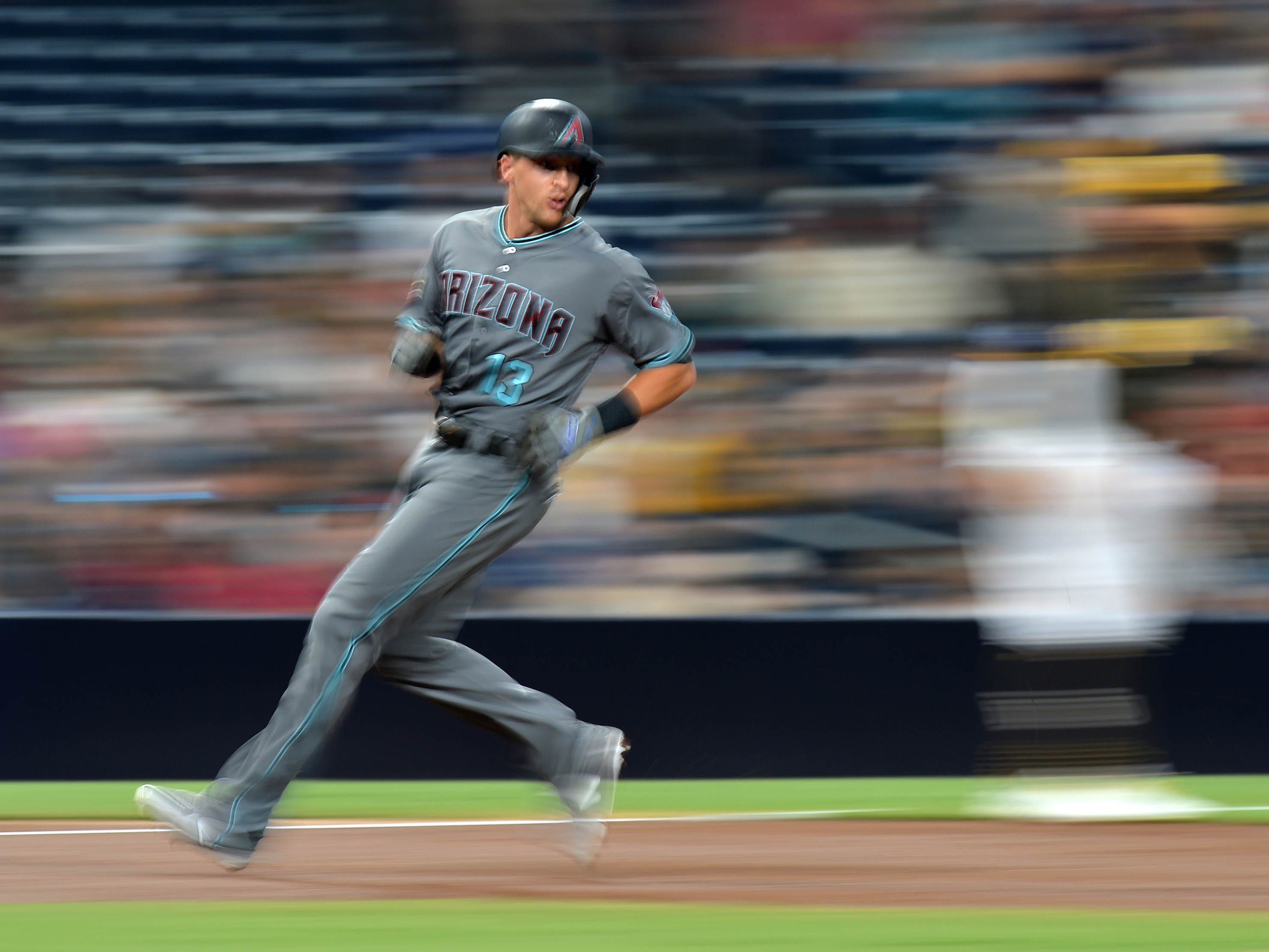 Aug 17, 2018: Arizona Diamondbacks shortstop Nick Ahmed (13) advances to third on a double by second baseman Ketel Marte (not pictured) during the second inning against the San Diego Padres at Petco Park.