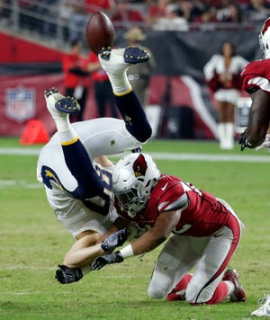 Arizona Cardinals defensive back A.J. Howard, right, commits a personal foul against Los Angeles Chargers tight end Sean Culkin for a 15-yard penalty during the first half of a preseason NFL football game, Saturday, Aug. 11, 2018, in Glendale, Ariz.