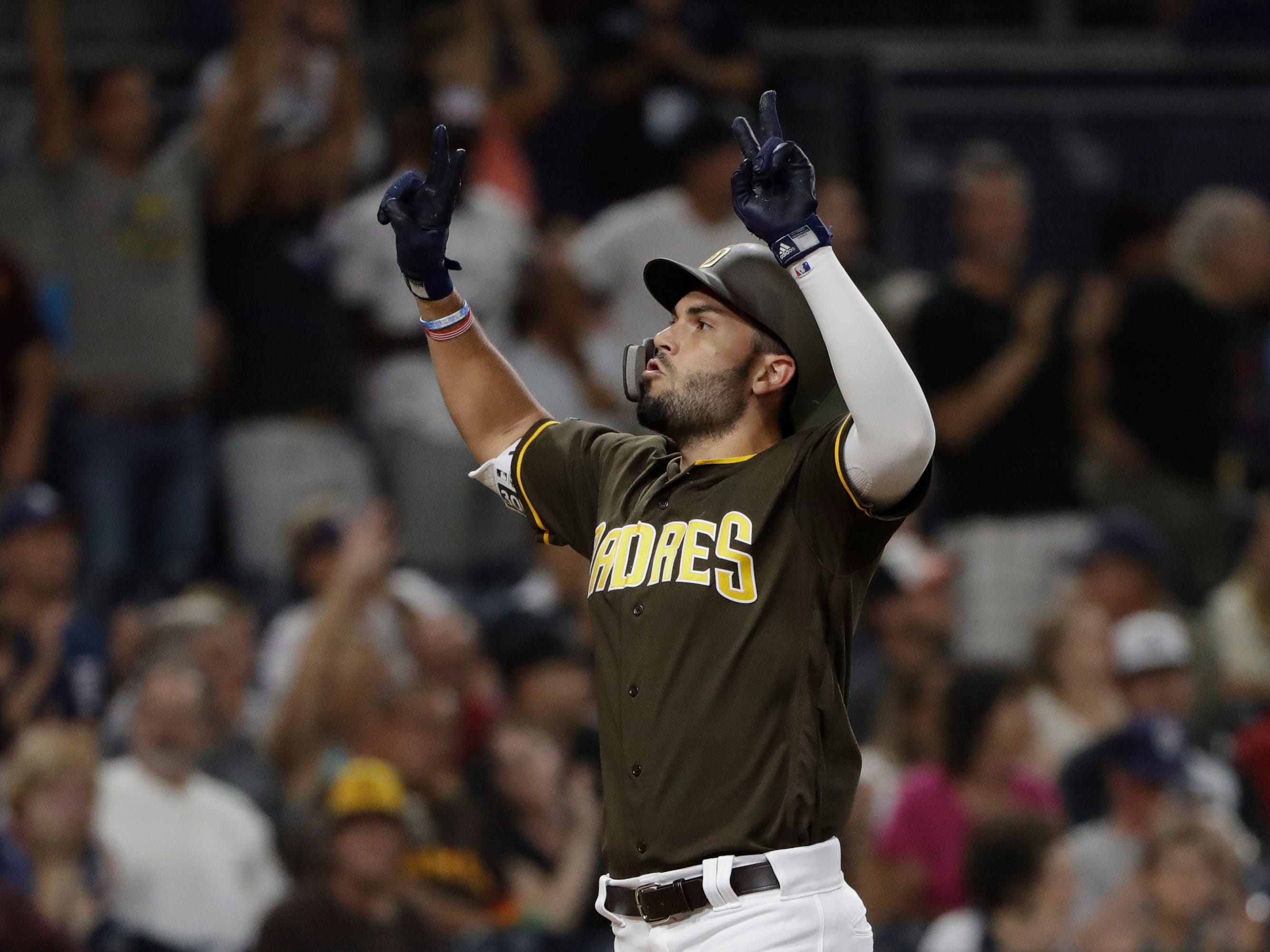 San Diego Padres' Eric Hosmer reacts after hitting a home run during the fifth inning of a baseball game against the Arizona Diamondbacks Friday, Aug. 17, 2018, in San Diego.