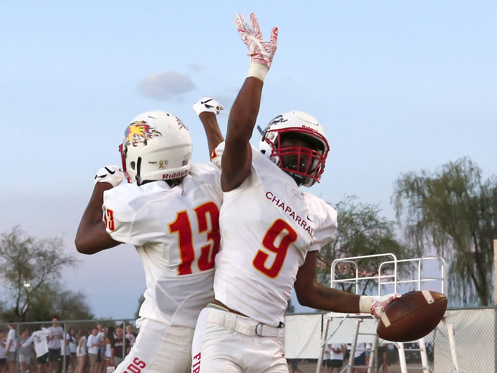 Chaparral Deavon Crawford (9) celebrates his touchdown with teammate Marcus Norvell II (13) during a high school football gameagainst the Hamilton at Hamilton in Chandler on August 17, 2018. #hsfb