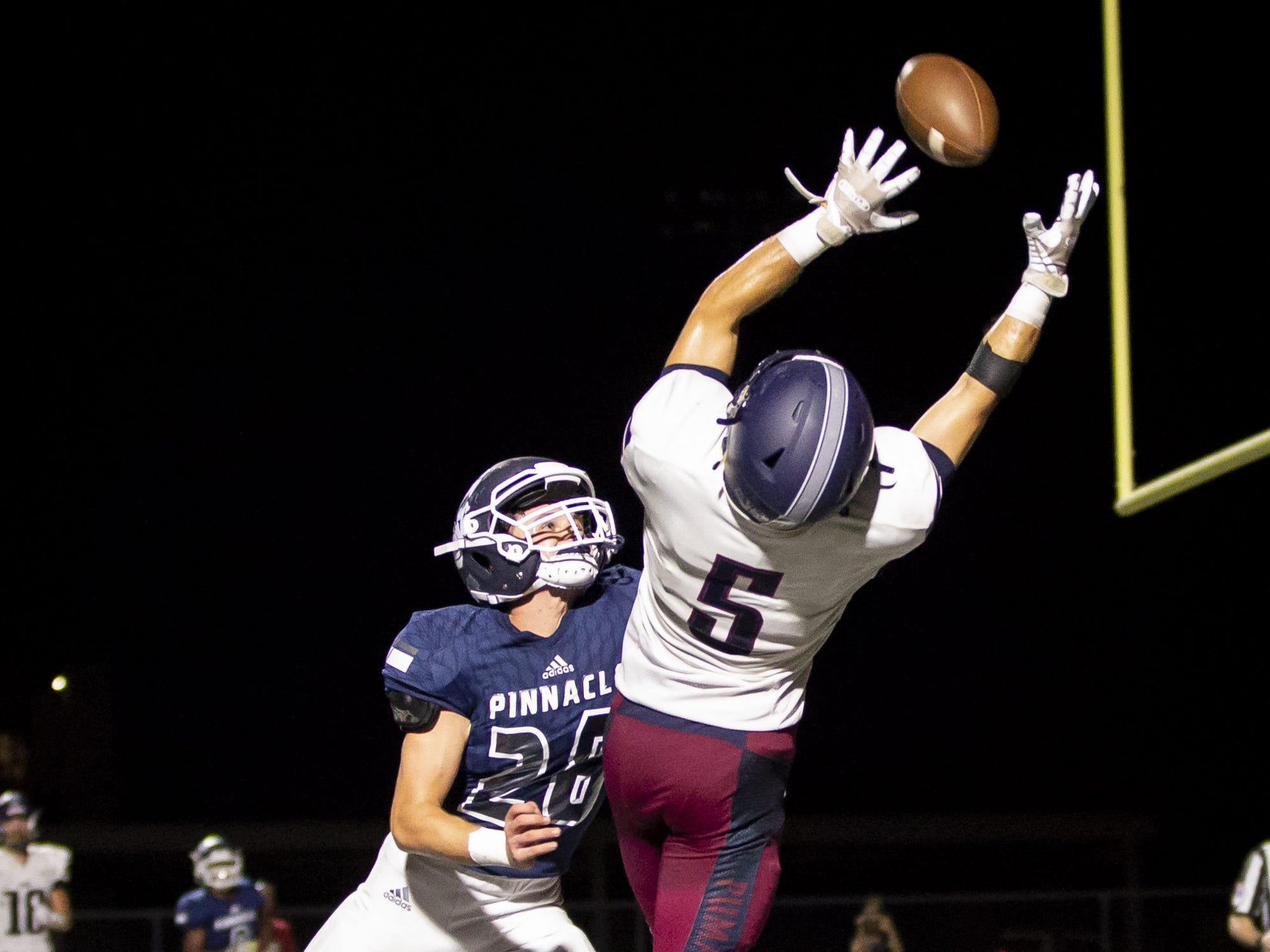Wide receiver Colby Dickie (5) of the Perry Pumas is unable to haul in a pass against defender Jack Havener (28) of the Pinnacle Pioneers at Pinnacle High School on Friday, August 17, 2018 in Phoenix, Arizona.