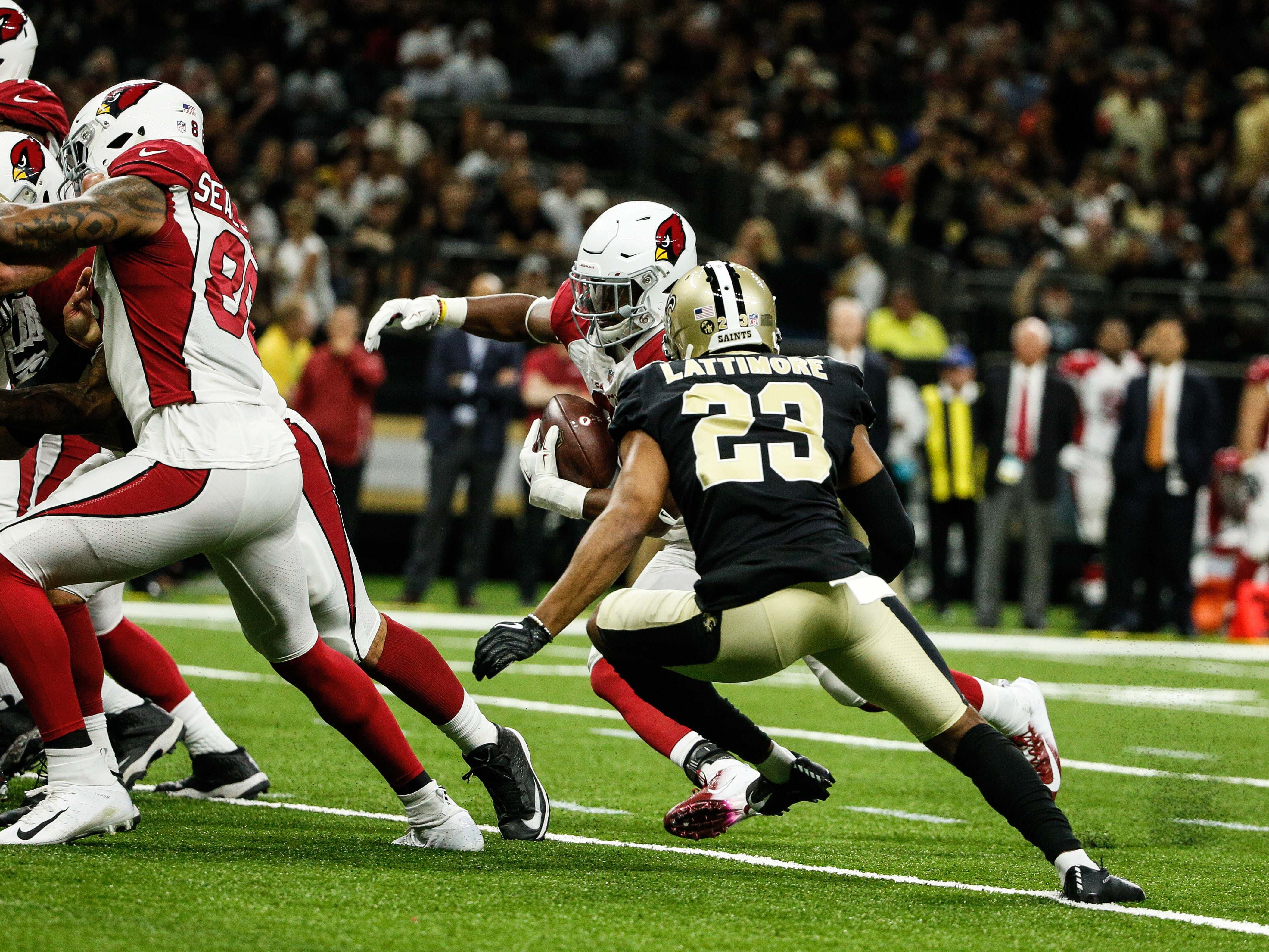 Aug 17, 2018: Arizona Cardinals running back David Johnson (31) runs past New Orleans Saints cornerback Marshon Lattimore (23) during the second quarter of a preseason game at the Mercedes-Benz Superdome.