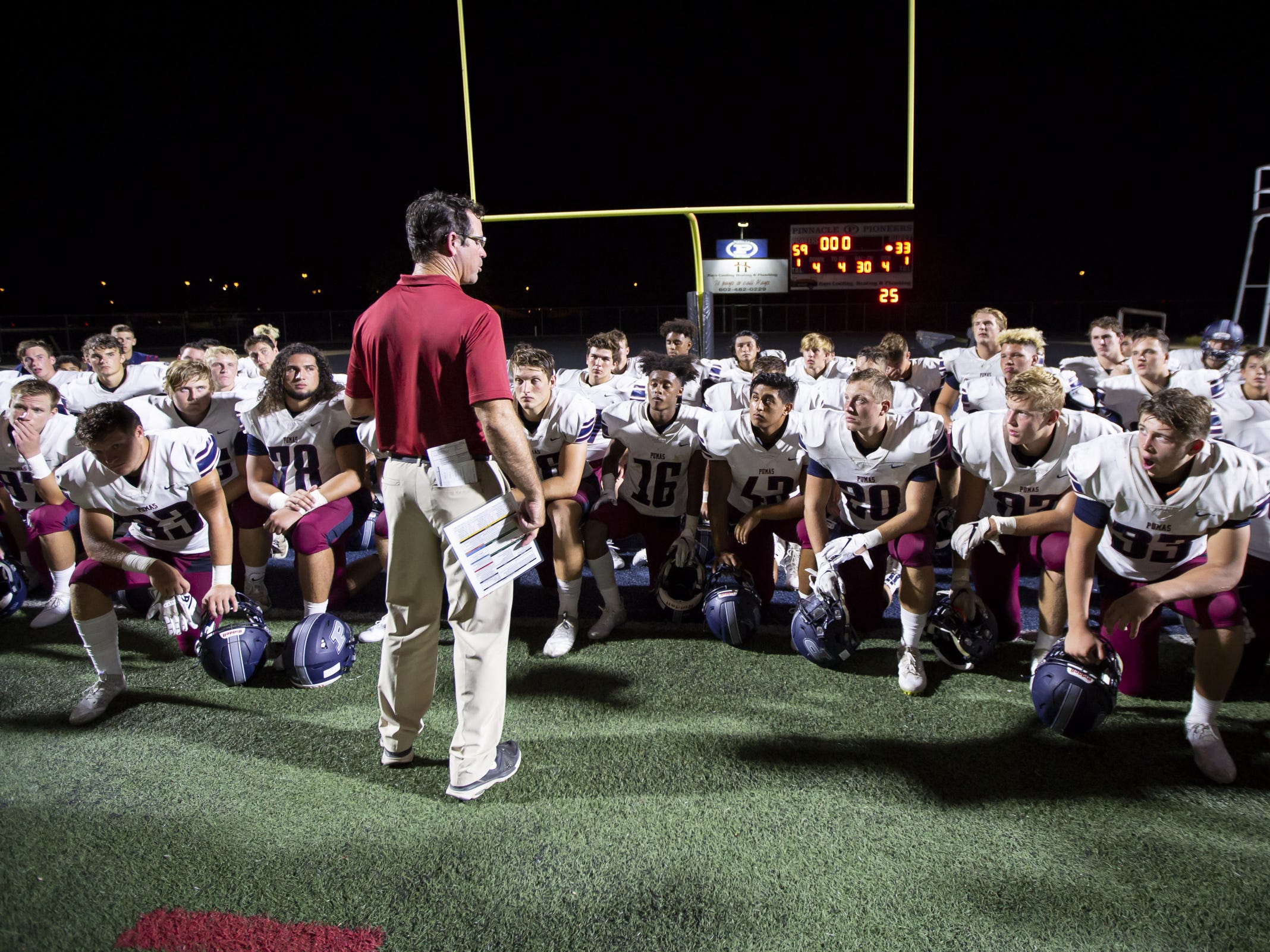 Head coach Preston Jones of the Perry Pumas speaks following Perry's loss against the Pinnacle Pioneers at Pinnacle High School on Friday, August 17, 2018 in Phoenix, Arizona.