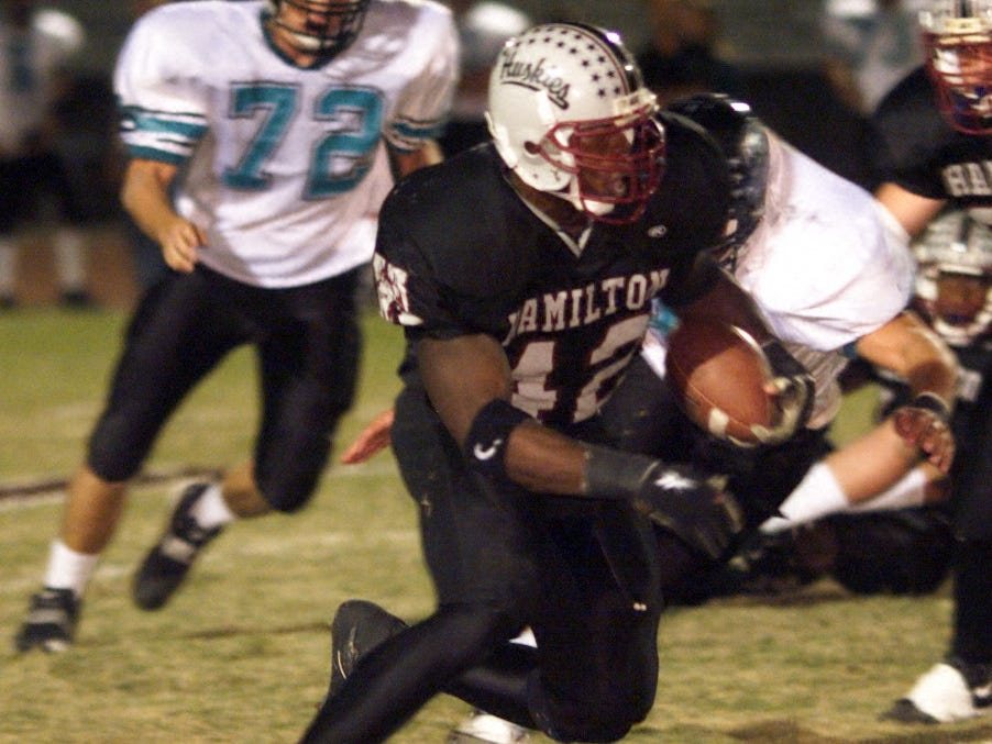 Chandler Hamilton's star running back Terrell Suggs (#42, center) has some daylight as he heads upfield against Gilbert Highland  (#72 Brad Copple is at far left for Highland) in the first half tonight in Chandler.