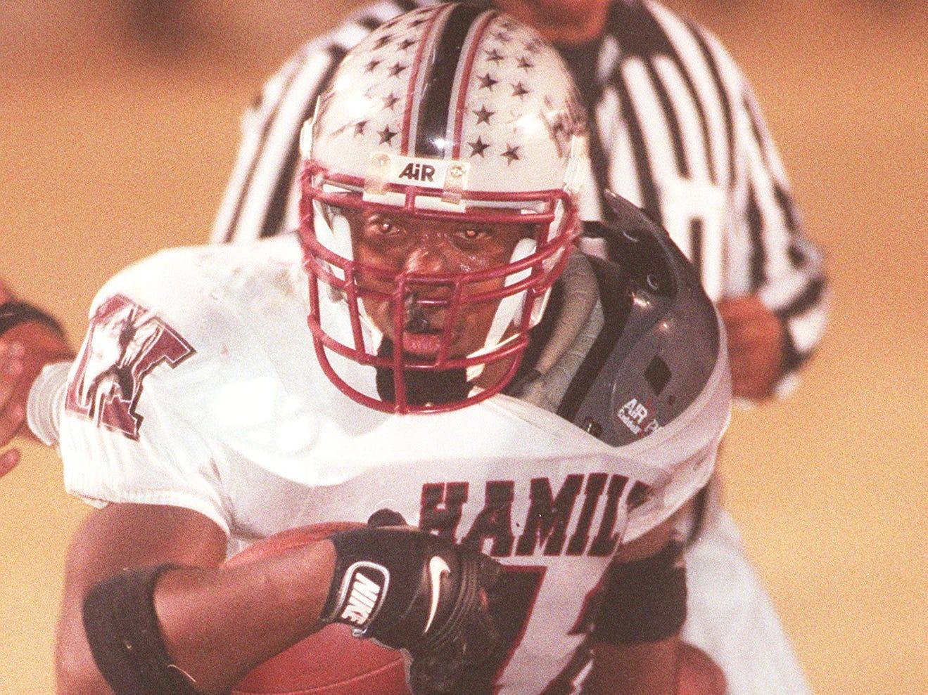 Hamilton High School's running back Terrell Suggs runs into the endzone to score Hamilton's first touchdown against Mountain View High School.