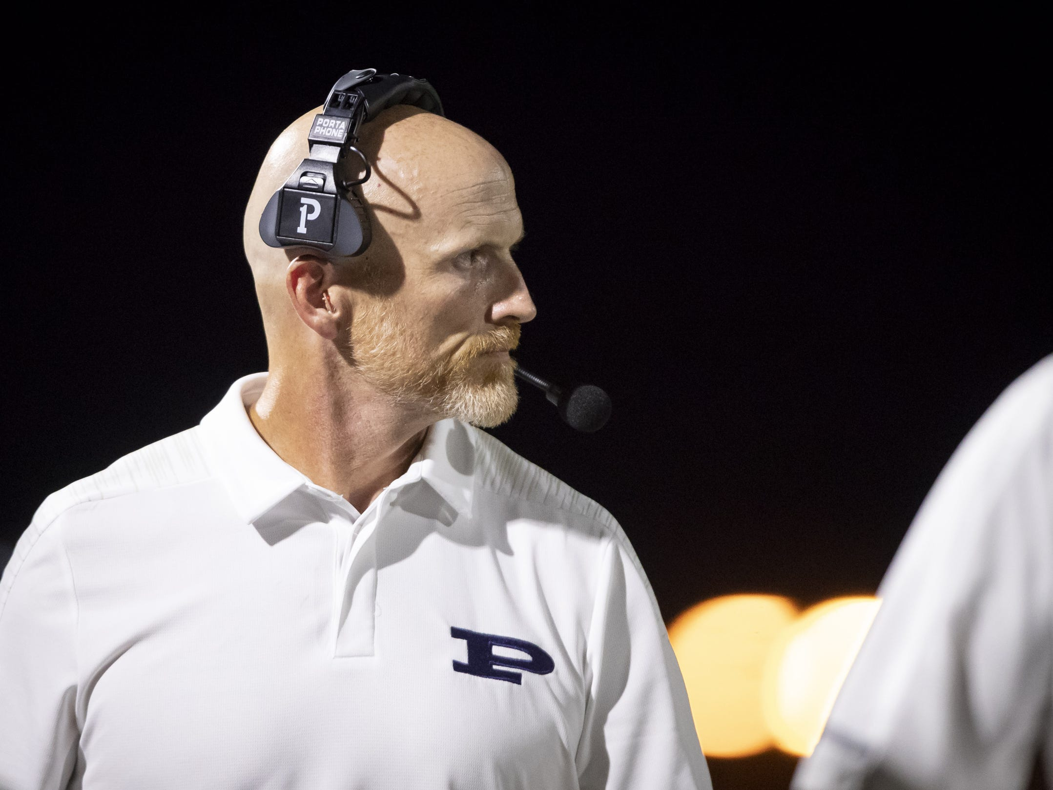 Head coach Dana Zupke of the Pinnacle Pioneers looks on during the game against the Perry Pumas at Pinnacle High School on Friday, August 17, 2018 in Phoenix, Arizona.