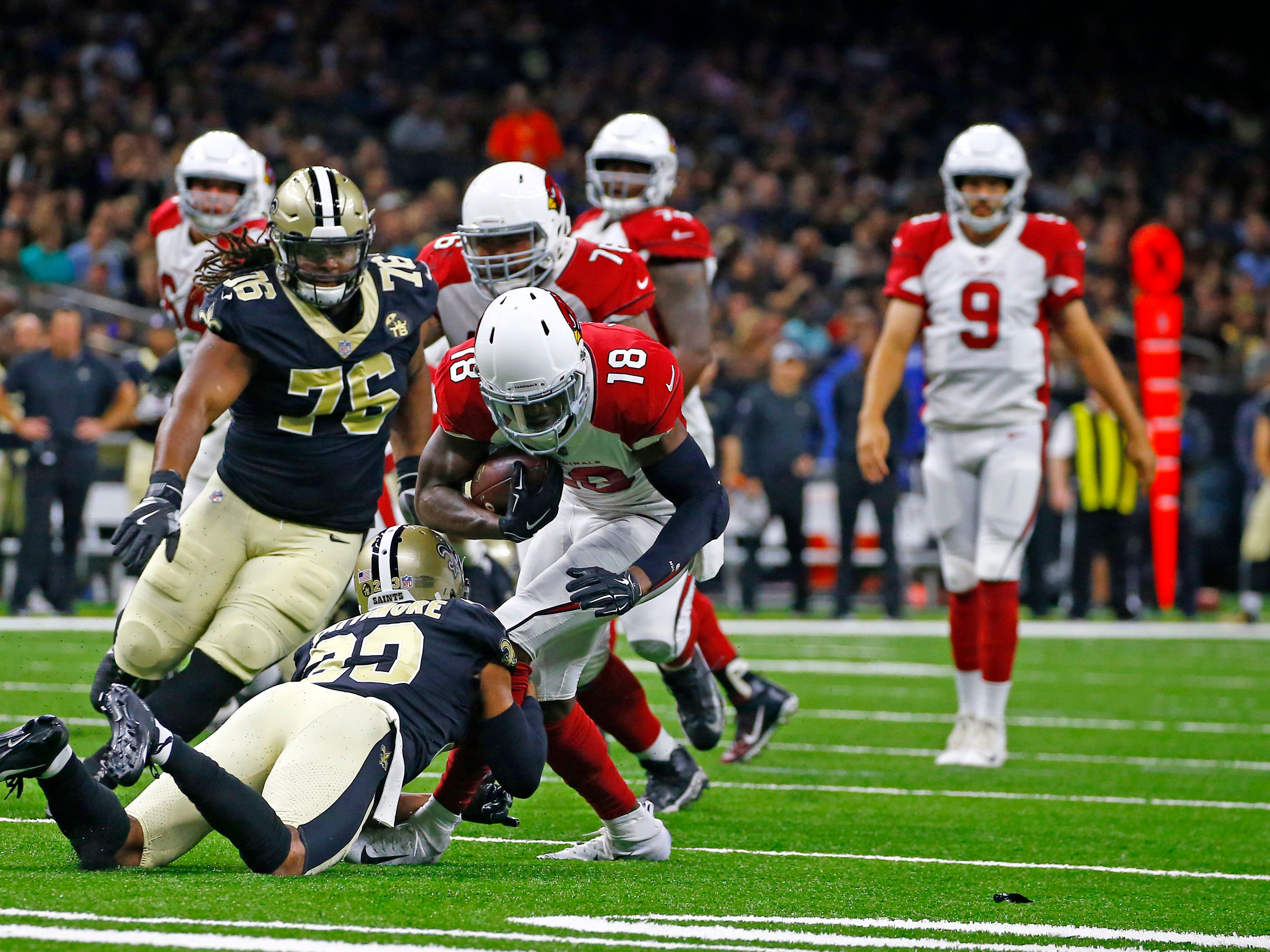 Arizona Cardinals wide receiver Greg Little (18) carries against New Orleans Saints safety Marshon Lattimore in the first half of an NFL preseason football game in New Orleans, Friday, Aug. 17, 2018.