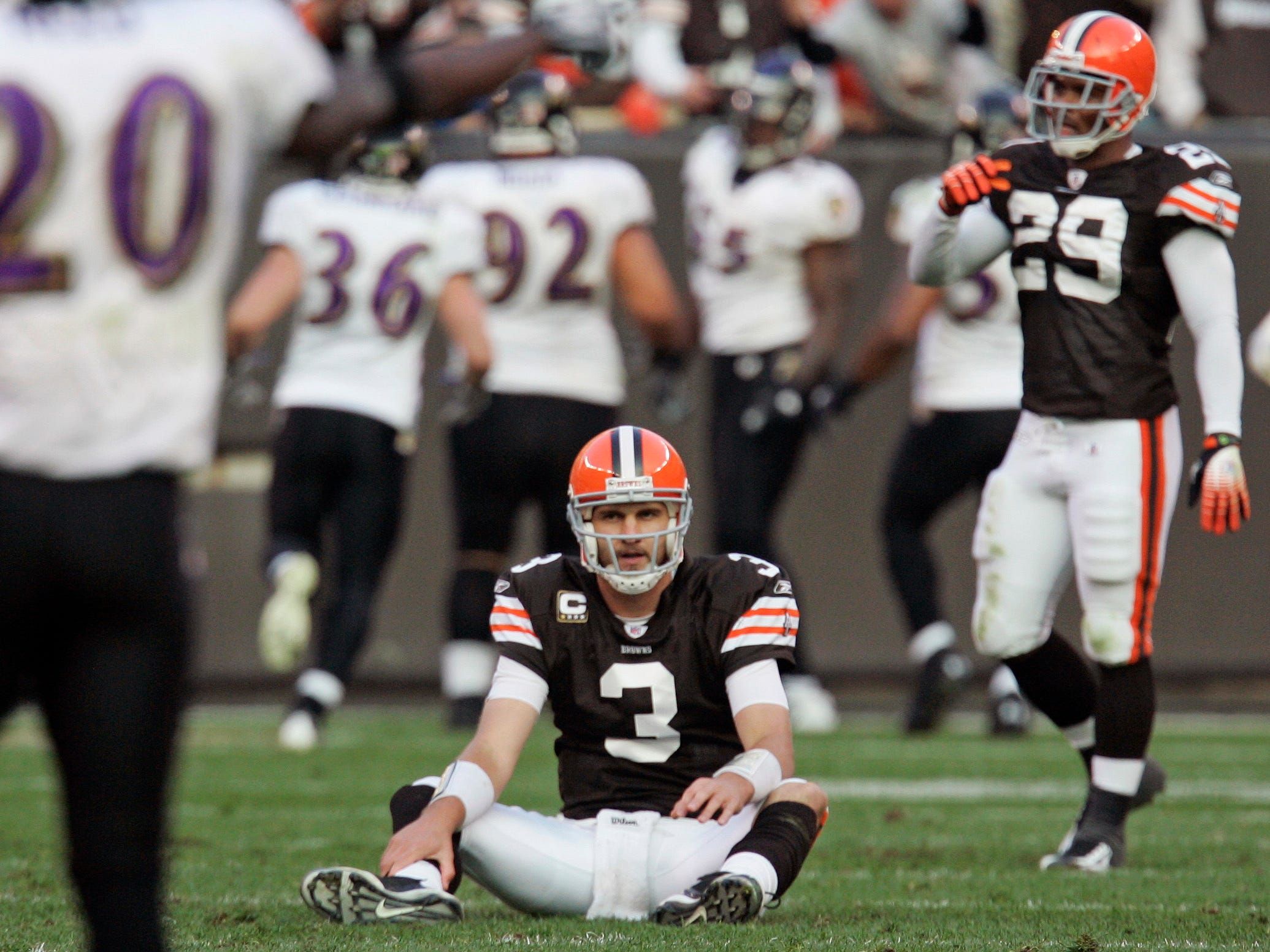 Cleveland Browns quarterback Derek Anderson (3) sits on the turf after throwing an interception that Baltimore Ravens linebacker Terrell Suggs returned for a touchdown in the fourth quarter of an NFL football game Sunday, Nov. 2, 2008, in Cleveland. Baltimore won 37-27.