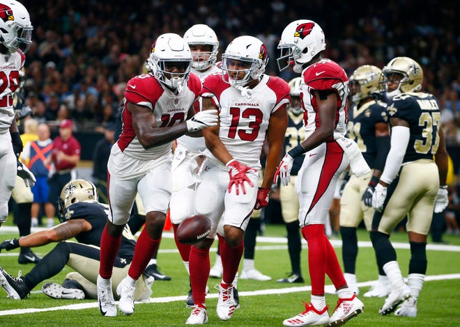 Arizona Cardinals wide receiver Christian Kirk (13) celebrates his touchdown reception in the first half of an NFL preseason football game against the New Orleans Saints in New Orleans, Friday, Aug. 17, 2018.