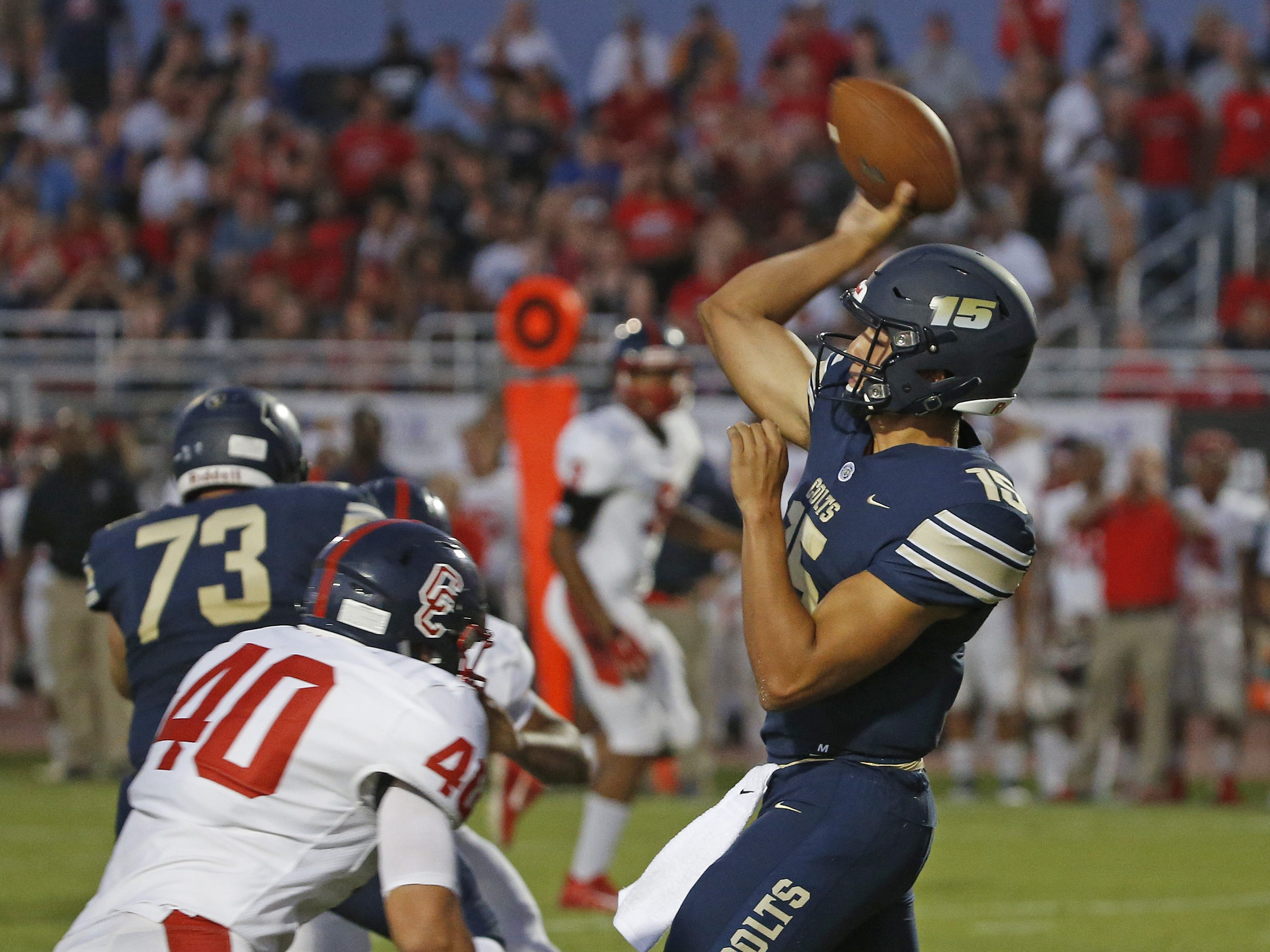 Casteel's Gunner Cruz (15) throws a pass against Centennial during the first half at Casteel High School in Queen Creek, Ariz. on Aug. 17, 2018.