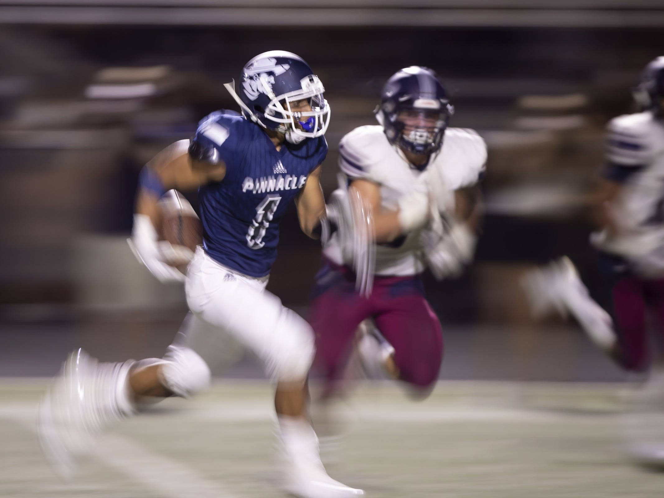 Running back Kaleb Covington (1) of the Pinnacle Pioneers runs the ball in for a touchdown against the Perry Pumas at Pinnacle High School on Friday, August 17, 2018 in Phoenix, Arizona.