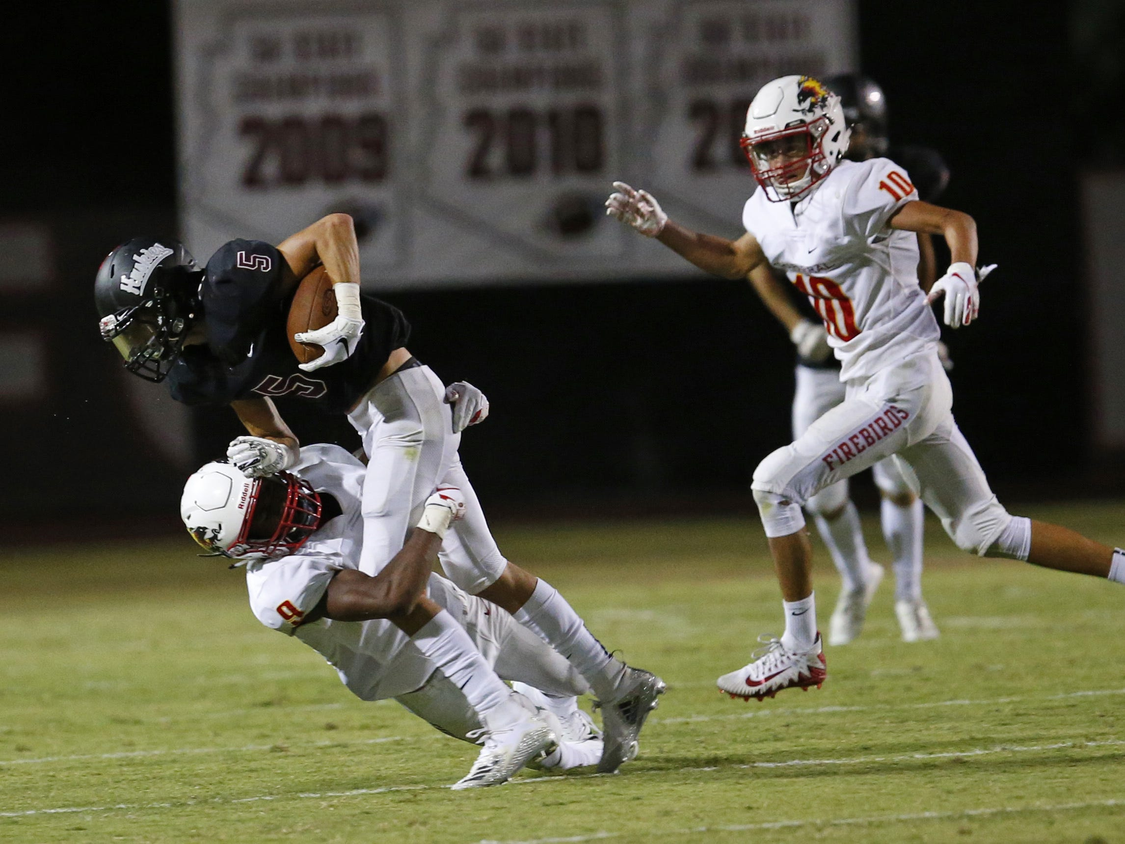 Chaparral Deavon Crawford (9) tackles Hamilton Bryce Danielson (5) during a high school football game at Hamilton in Chandler on August 17, 2018. #hsfb