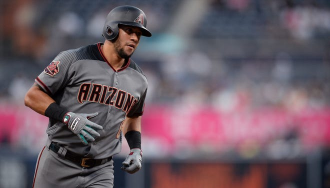 Arizona Diamondbacks' David Peralta rounds the bases after hitting a three-run home run during the first inning of a baseball game against the San Diego Padres Thursday, Aug. 16, 2018, in San Diego.